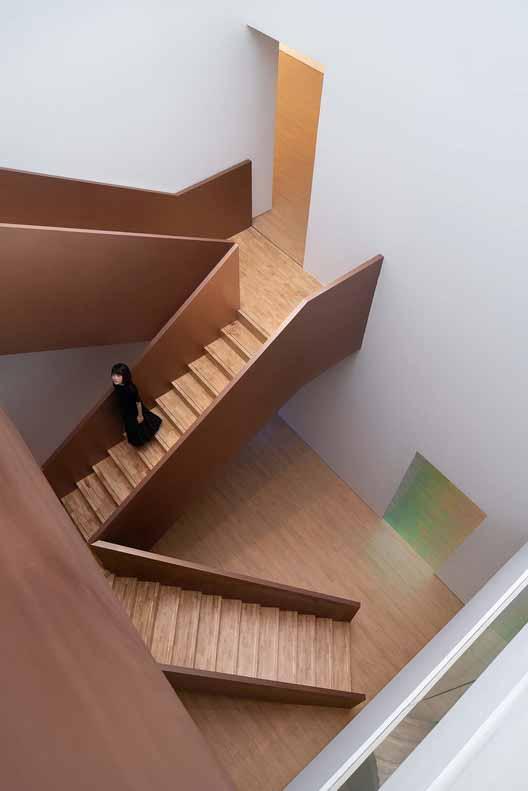 с видом на атриум с 3 этажа. Изображение © Qingshan Wu