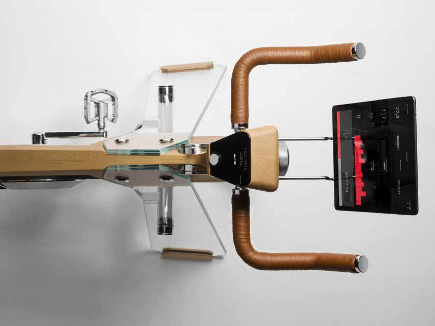 Вид с воздуха на велотренажер от Elite и Adriano design со стеклянными ножками и деревянной рамой
